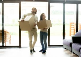 Young Millennial couple moves into new home