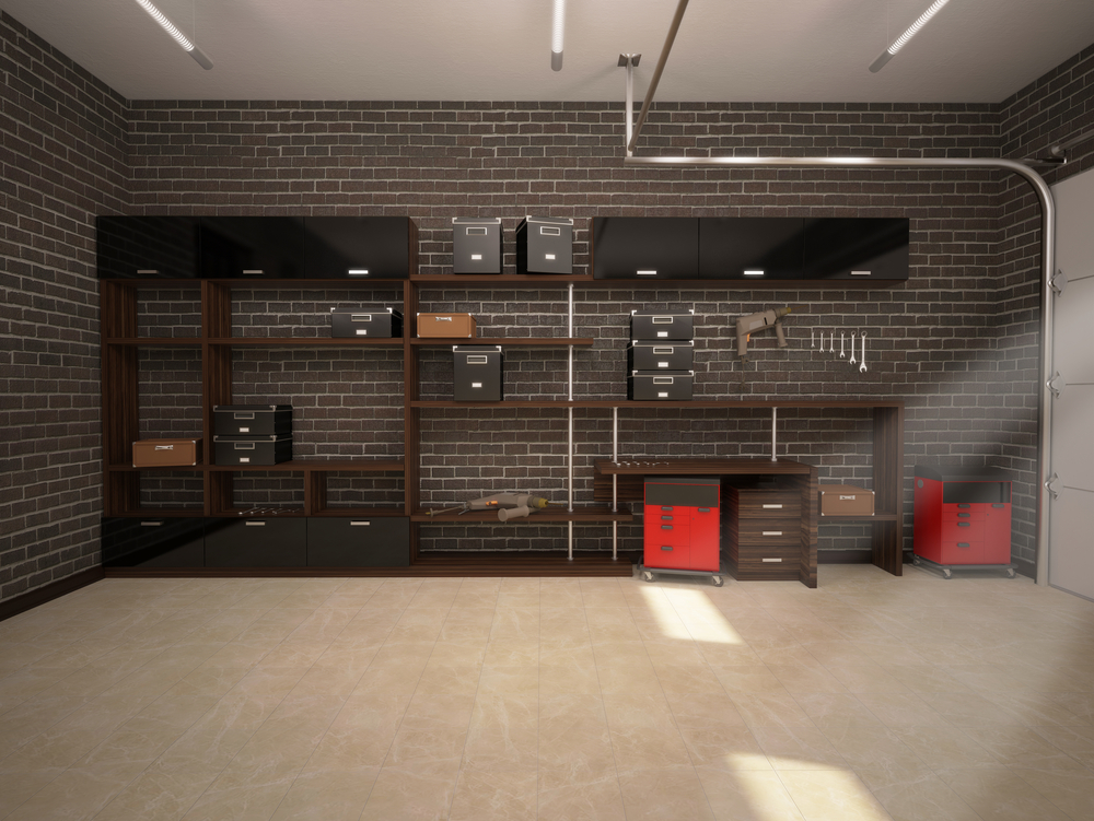 A garage workshop customized with a brick back wall, a work bench and storage